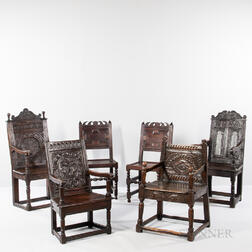 Four Oak Panel-back Open Armchairs and a Pair of Oak Back Stools