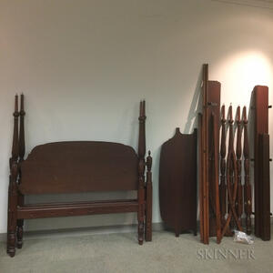 Two Reproduction Carved Mahogany Four-post Beds and a Trundle Bed