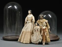 Three Papier-mache Lady Dolls, a Wooden Doll, and Two Glass Display Domes