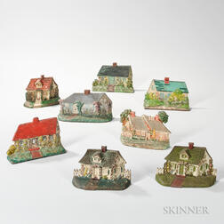 Eight Polychrome Decorated Cast Iron Doorstops