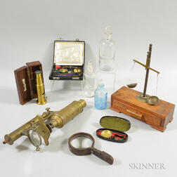 Three Glass Apothecary Bottles, Two Microscopes, a Portable Scale, and a Magnifying Glass.     Estimate $200-300