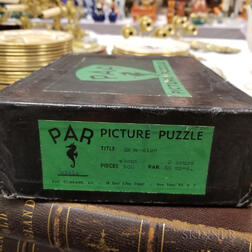 Boxed PAR Lithographed Wood Jigsaw Puzzle of a Revolutionary War Scene.     Estimate $400-600