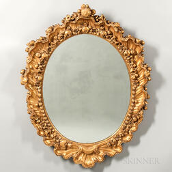 Pair of Carved and Gilded Oval Mirrors