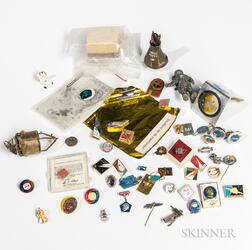 NASA Memorabilia Collection: Pins, Small Flown Material Sample, and Other Material.
