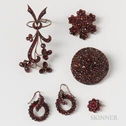 Two Garnet Brooches, a Large Garnet Ring, a Pair of Garnet Earrings, and a Small Garnet Pendant.     Estimate $200-300