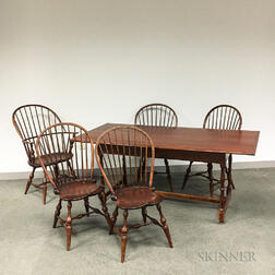 D.R. Dimes Jacobean-style Pine Dining Table and a Set of Four Bow-back Windsor Chairs, and a Sack-back Windsor Chair.