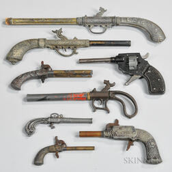 Eight Toy Cap and/or Pop Guns