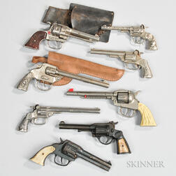 Eight Cast Iron Toy Cap Guns and Two Holsters