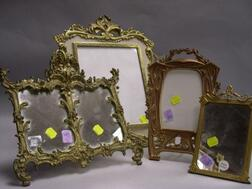Four Cast Gilt-metal and Brass Table Frames.