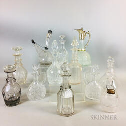 Twelve Cut and Etched Colorless Glass Decanters