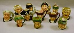 Twelve Small and Mid-Size Royal Doulton Character Jugs, Decanters, and Smoking   Items