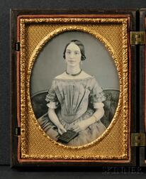 Quarter Plate Daguerreotype of a Young Woman Holding a Union Case