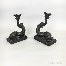 Two Wedgwood Black Basalt Dolphin Candlesticks