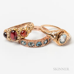 Two 14kt Gold and Aquamarine Rings and a 10kt Gold and Garnet Cabochon Ring