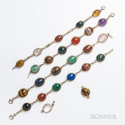 Four 14kt Gold and Carved Hardstone Scarab Bracelets
