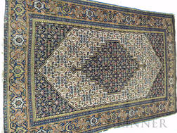 Senneh Rug, Northwest Persia, early 20th century, featuring a navy stepped and pendanted diamond-shaped center medallion on an ivory fi