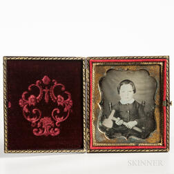 Sixth-plate Tinted Daguerreotype of a Seated Boy Holding a Hatchet