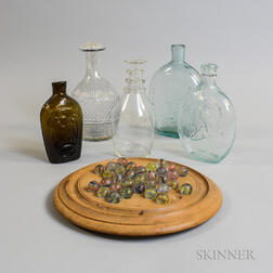 Five Glass Bottles and Flasks, a Set of Marbles, and a Game Board