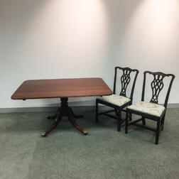 Two Georgian Mahogany Side Chairs and a Tilt-top Breakfast Table.     Estimate $150-250