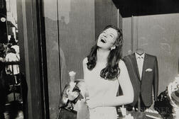 Garry Winogrand (American, 1928-1984)      Laughing Woman with Ice Cream Cone
