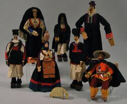 Seven Carved Wood and Paint-decorated Dolls