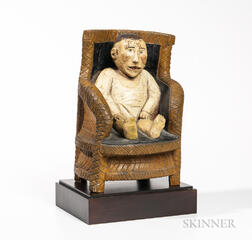 Carved and Painted Baby in a Chair Figure