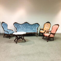 Rococo Revival Carved Walnut Sofa, Two Side Chairs, a Marble-top Side Table, and a Rocking Chair.     Estimate $200-300