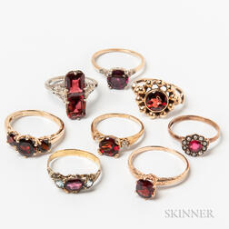 Eight Gold and Garnet Rings