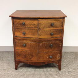 Diminutive Mahogany and Walnut-veneered Bow-front Commode
