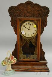 Gilbert Capitol No. 44 Pressed Oak Gingerbread Shelf Clock and a Painted Cast Iron   Basket of Flowers Doorstop