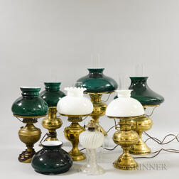 Six Brass Kerosene Lamps and a Pressed Glass Lamp.     Estimate $100-200
