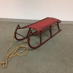 Red-painted Wrought Iron and Wood Sled