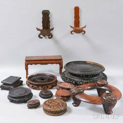 Twelve Wooden Stands and a Lid