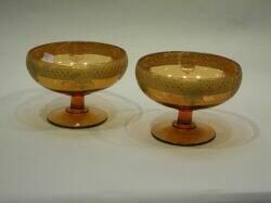Pair of Continental Parcel-gilt Amber Glass Footed Bowls.