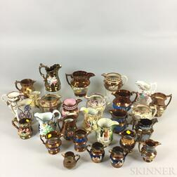 Approximately Thirty-two Mostly Copper Lustre Jugs and Pitchers