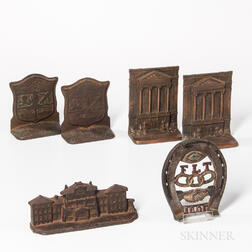 Two Pairs of Odd Fellows Bookends, a Doorstop and a Trivet