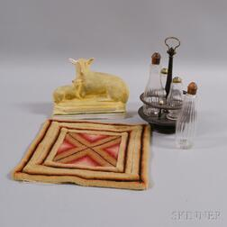 Chalkware Figure of a Sheep and Lamb, a Cruet Set, and a Needlepoint Mat.     Estimate $20-200