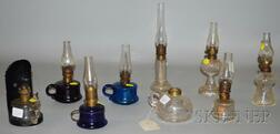 Nine Small Pressed Glass Oil Lamps