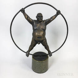 Bronze Sculpture of Large Nude Man in the Center of a Ring