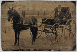 Large Tintype Depicting a Black Coachman in a Carriage