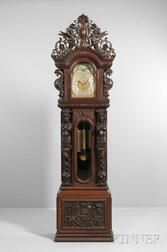 J.J. Elliott Monumental Carved Mahogany Quarter-chiming Hall Clock