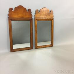 Pair of Eldred Wheeler Queen Anne-style Maple Mirrors