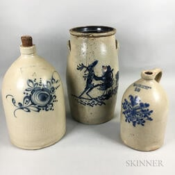 Two Cobalt-decorated Stoneware Jugs and a Churn