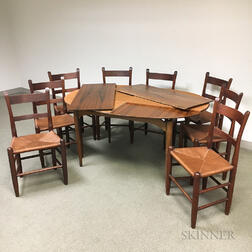 Mid-Century Modern Teak Dining Table and a Set of Eight Ladder-back Dining Chairs.     Estimate $600-800