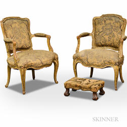 Pair of French Provincial Painted Gesso and Fruitwood Fauteuils and a Footstool