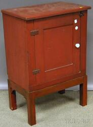 Red-painted Wooden Cabinet with Paneled Door