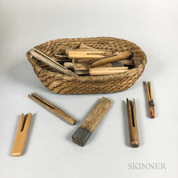 Group of Carved Wood Clothespins and a Woven Rush Basket