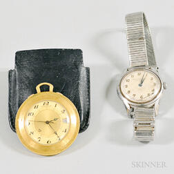 Jaeger LeCoultre Travel Memovox Calibre 911 and a Girard Perrigaux Gyromatic Wristwatch.     Estimate $50-100