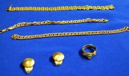 Three 14kt Gold Link Bracelets, a 14kt Gold Friendship Ring, and Pair of 18kt Gold Earclips.