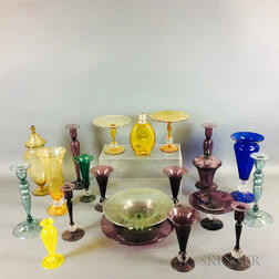 Twenty-one Pieces of Colored Etched Glass Tableware.     Estimate $20-200